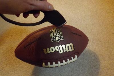 Cut open the football.