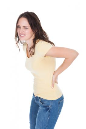 Woman experiencing pain from kidney stones