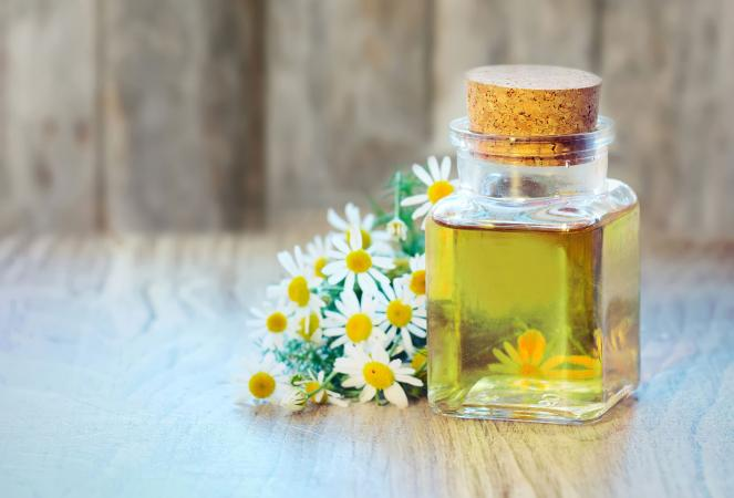 Chamomile oil bottle with flowers