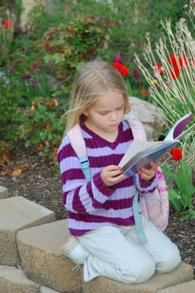 girl reading in garden