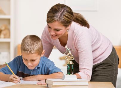 Mom helping son with school work