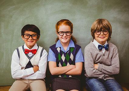 School kids smiling in classroom