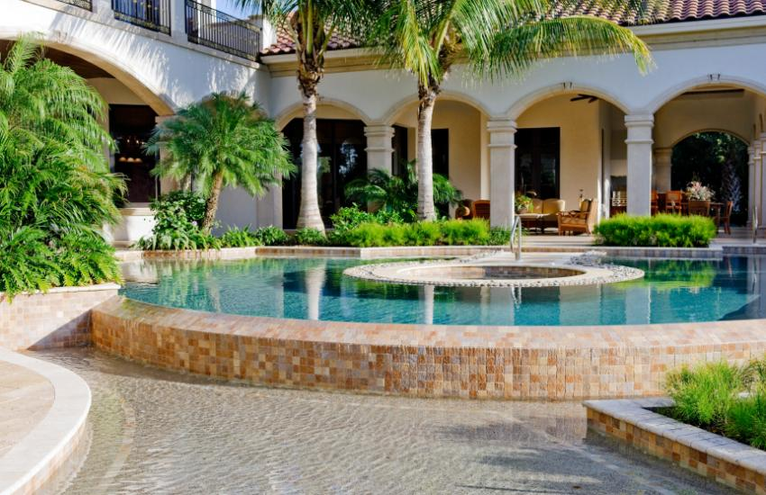 Swimming pool design ideas slideshow for Raised pool designs
