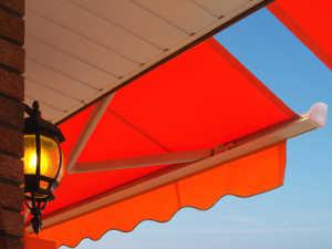 Orange fabric patio awning.