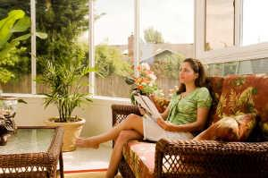 Woman enjoying her screened-in patio.
