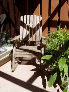 Rocking chair under a covered patio.