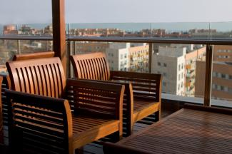 rooftop deck wood furniture and railings