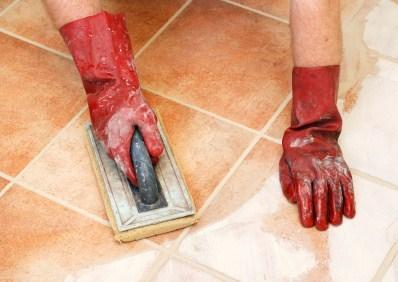 Applying grout on a tile floor