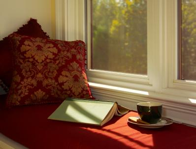 Bay window seats are a comfortable place to read and relax.