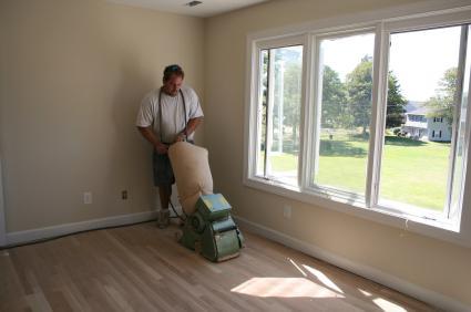 man sanding floor