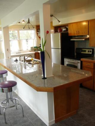 Island With Breakfast Bar And Granite Top Charming Kitchen Decoration