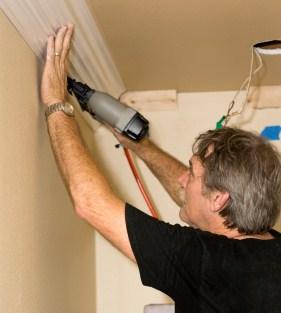 man installing molding