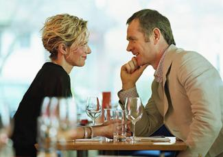 Couple in discussion while fine dining