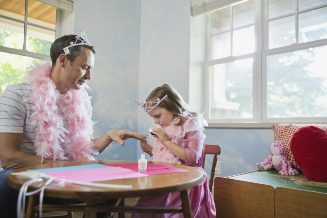Girl painting fathers fingernails