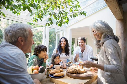 family talking in kitchen