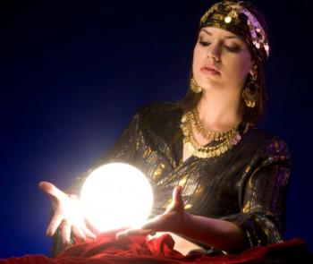 Woman with illuminated crystal orb
