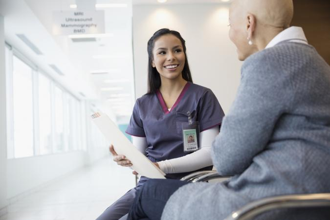Nurse discussing medical chart