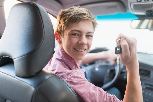 Teenage boy driving his first car