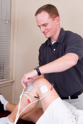 Physical therapist in session with a patient