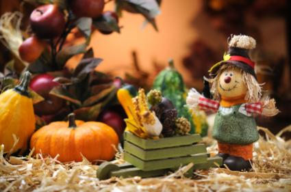 Thanksgiving figurines with miniature pumpkin