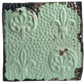 Antique tin ceiling tile painted to look like plaster
