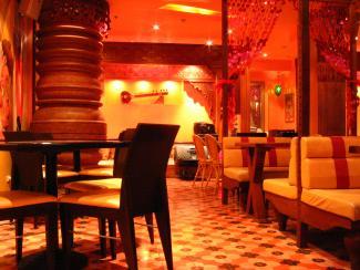 Red Tones Used In Interior Of Restaurant