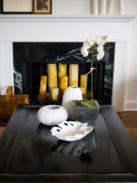 White sea urchin vases on coffee table