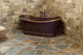 stone and copper bathroom
