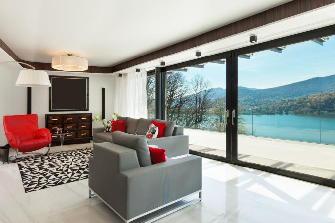 Sliding glass doors on wall with sheer treatment
