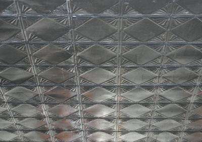 Geometric embossed ceiling tiles