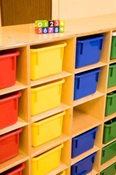 Bins help keep playrooms organized.
