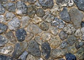 Irregular stone wall effect.
