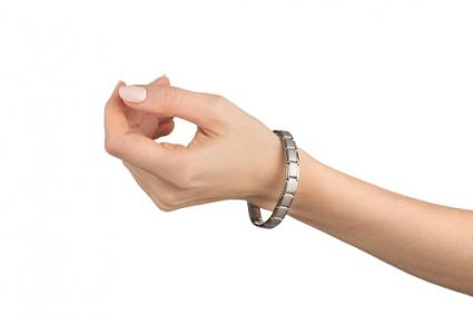 Woman hand with magnetic bracelet