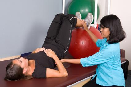 Occupational Therapist assisting patient