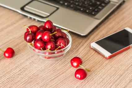 Healthy snack in the office - bowl of cherries