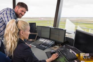 Air traffic controllers working in air control tower