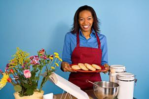Woman presenting plate of cookies