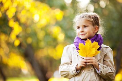 Girl Holding Fall Leaves
