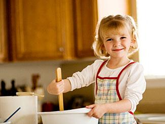 child stirring batter