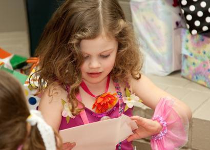 Birthday girl opening a card