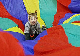 child playing parachute game