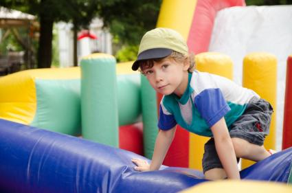 Boy going through obstacle course