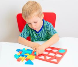 Little boy with shape puzzle