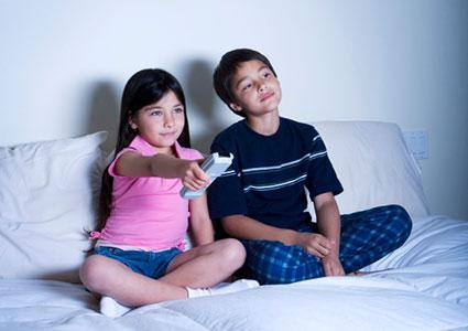 two kids watching television