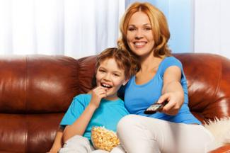 Woman and child watching tv
