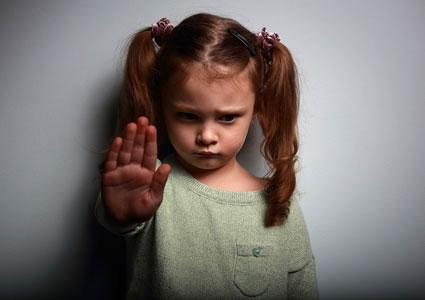 Girl signaling to stop violence