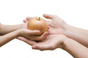 child passing apple