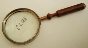 Magnifying glass with clue