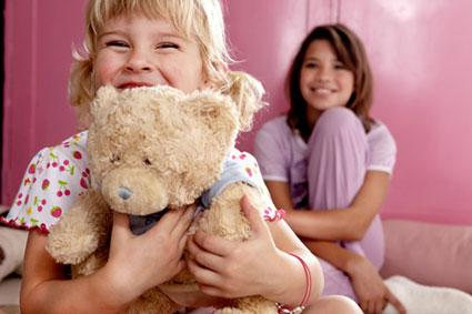 Children with well-loved teddy bear