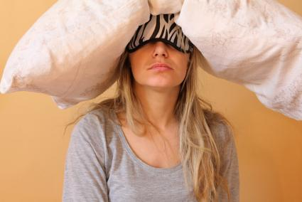 Woman with pillow on head